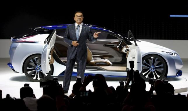 Carlos Ghosn, CEO of the Renault-Nissan Alliance speaks in front of the Nissan IDS concept car during a presentation at the 44th Tokyo Motor Show in Tokyo, Japan, October 28, 2015. REUTERS/Toru Hanai
