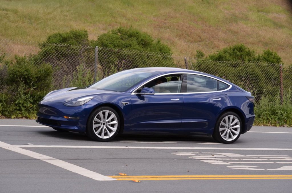 tesla model 3 test car on road